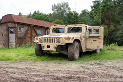 Military vehicle stands on green terrain Stock Photo
