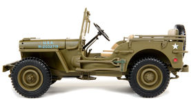 Military vehicle toy. On the white background royalty free stock photography