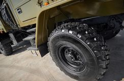 Military vehicle truck wheels on hub with black shine tires. New clean off road transport truck all terrain wheels for. High resol. Ution image of off road mud royalty free stock image