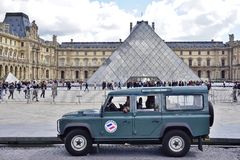 Military vehicles in front of the Louvre Pyramid in Paris Stock Images