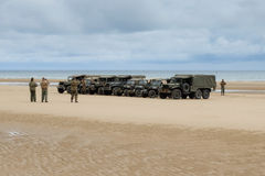 Military vehicles at Omaha Beach for D-day anniversary commemora Royalty Free Stock Photo
