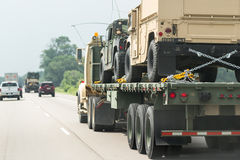 Military vehicles on the road. Highway 90/94,  Wisconsin - July 07 : Military vehicles being relocated from one base to another in the middle of the Jade Helm 15 Royalty Free Stock Images
