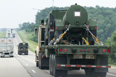 Military vehicles on the road. Highway 90/94,  Wisconsin - July 07 : Military vehicles being relocated from one base to another in the middle of the Jade Helm 15 Royalty Free Stock Photography