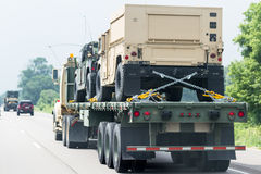 Military vehicles on the road Stock Images