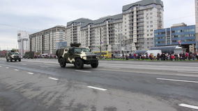 Military vehicles traveling through the city, Hummers, infantry, Russian army. Russian army, special car transports Battle Tank stock video