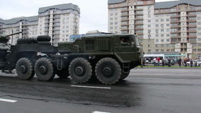 Military vehicles traveling through the city, Hummers, infantry, Russian army. Russian army, special car transports Battle Tank stock video footage