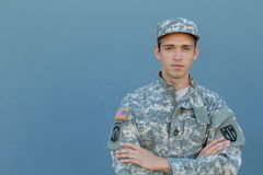 Military Veteran Isolated on Blue Background.  stock photos
