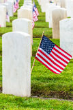 Military Veterans Headstones and American Flags. Rows of white marble headstones with American flags at Arlington of the West, Veterans Memorial Cemetery stock images
