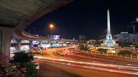 Military victory monument and elevated railway at twilight in Bangkok Stock Photo