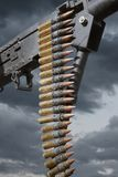 Military War Machine Gun Weapon. Military machine gun with dark cloudy skies background Stock Image