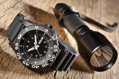 Military watch and flashlight Stock Image