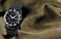 Military watch on sack background Royalty Free Stock Photography