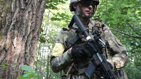 Military weapons are in the woods. The soldier is moving in the forest. Armed man. stock footage