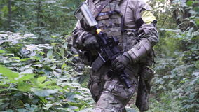 Military weapons are in the woods. The soldier is moving in the forest. Armed man. stock video footage
