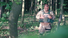 Military wears body armor in the forest stock footage