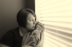 Military Wife. A military wife waits for her husband to return from war Stock Images