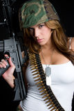 Military Woman. Tough military woman with gun Stock Photo