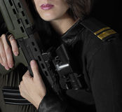 Military woman 4. This woman is holding a realistic british assault rifle replica Royalty Free Stock Photos
