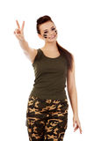 Military woman gesturing peace with fingers Stock Photo