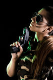 Military woman with a gun Royalty Free Stock Image