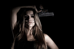 Military woman with a gun. Over black background Stock Photography