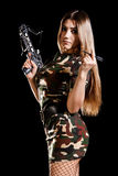 Military woman loading the arbalest Royalty Free Stock Photography