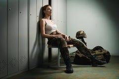 Military woman at locker room Stock Image