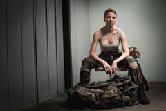 Military woman at locker room Royalty Free Stock Image