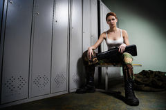 Military woman at locker room Royalty Free Stock Image