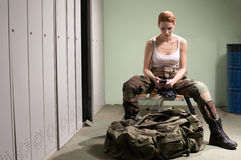 Military woman at locker room royalty free stock images