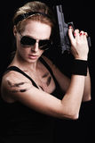 Military woman posing with gun Royalty Free Stock Photography