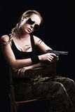 Military woman posing with gun Royalty Free Stock Images