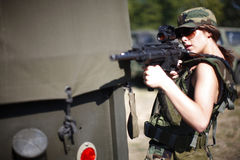Military woman with rifle Royalty Free Stock Photo