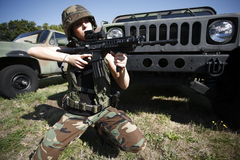 Military woman with rifle Stock Image