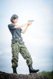 Military woman shooting a gun Royalty Free Stock Image