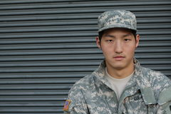 Military young Asian man. Studio portrait stock photography