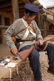 Soldier militiaman from 1800's assembles a musket at Bent's Fort historical reenactment Stock Images