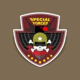 Militärt emblem med en skalle och vapnet, vingar på skölden WA Arkivbild