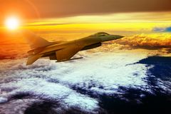 Militry plane flying over cloud scape Stock Photo