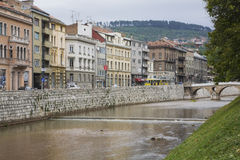 Miljacka river and old architectural commercial and residential buildings, Sarajevo, Bosnia and Herzegovina Stock Photography