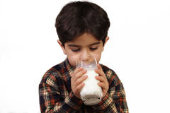Milk. The boy drinking milk, isolated on white stock image