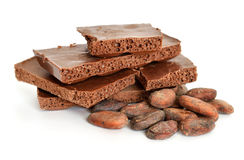 Milk air chocolate with Cocoa beans before roast. Stock Photography