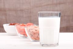 Milk, almonds, raisins, dried apricots on the table side view Stock Images