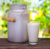 Milk in aluminum can and glass. Stock Photo