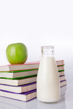 Milk, apple and books Royalty Free Stock Photography