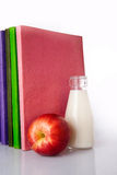Milk, apple and books Royalty Free Stock Photos
