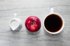 Milk, apple and coffee for breakfast Royalty Free Stock Images