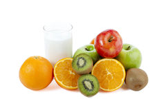 Milk and assorted fruits stock photos