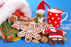 Milk and assortment of gingerbread cookies for santa Stock Images