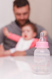 Milk baby bottle  staying on the table Stock Image